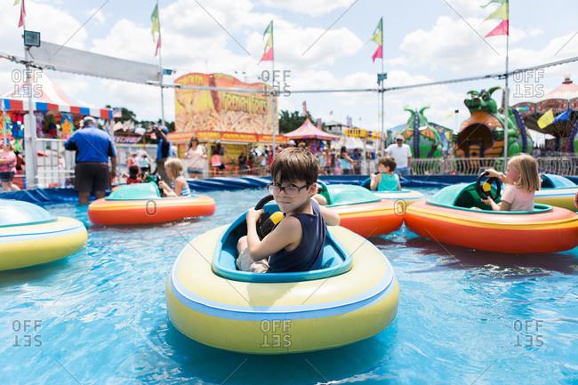 Boy on bumper boats at a fair
