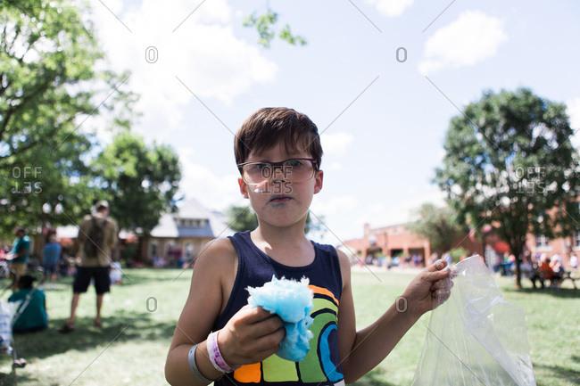 Young boy eating cotton candy