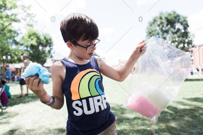 Young boy with blue and pink cotton candy