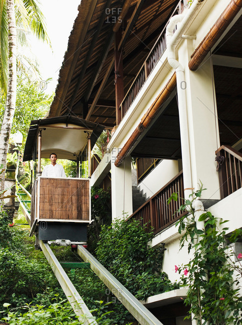 A man rides the funicular at a hotel, Bali, Indonesia