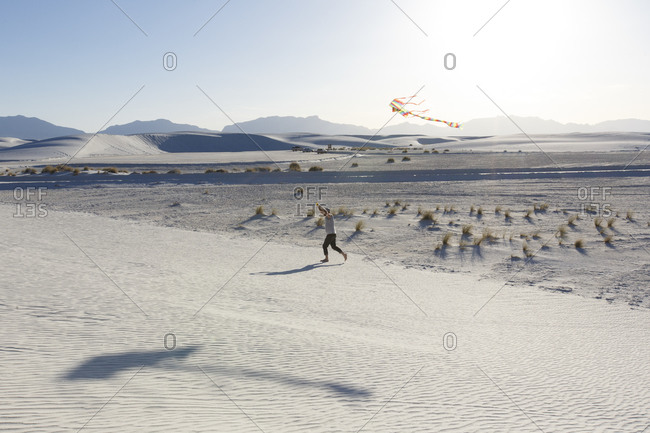 Man flying a kite in White Sands, New Mexico