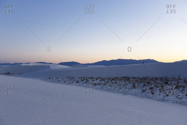 Tourist at dusk in White Sands, New Mexico