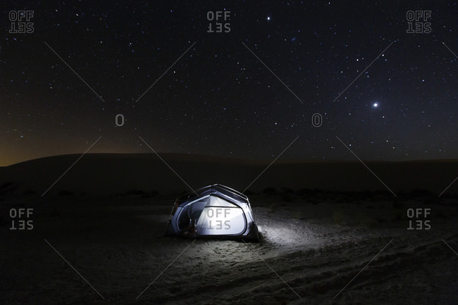 Camp at night in White Sands, New Mexico