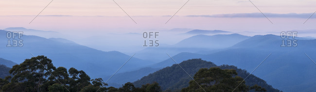 Panoramic view of misty mountains