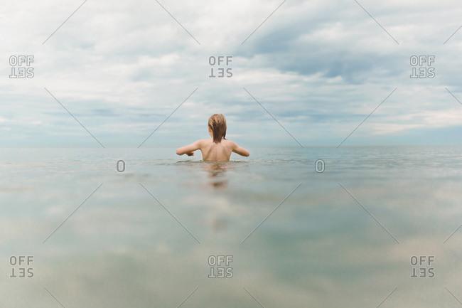 A boy ventures away from the beach