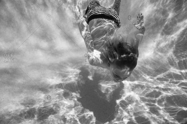 A boy swims underwater