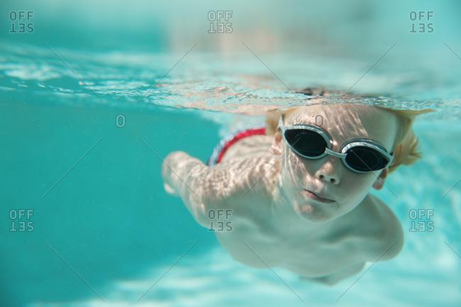 A boy swimming underwater