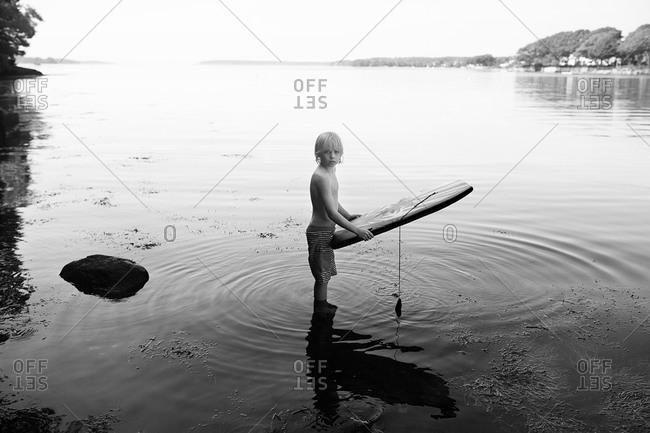 A boy takes a break from boogie boarding