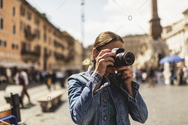 Tourist photographing architecture in Rome, Italy