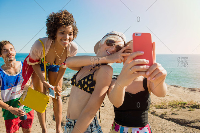 Group of friends at the beach taking a selfie