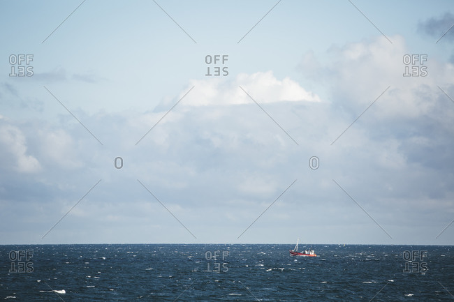 View to Baltic Sea with fishing boat, Nienhagen