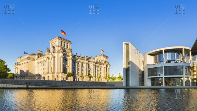 Berlin, Germany - July 21, 2015: Reichstag and Paul-Loebe building at the river Spree, Berlin