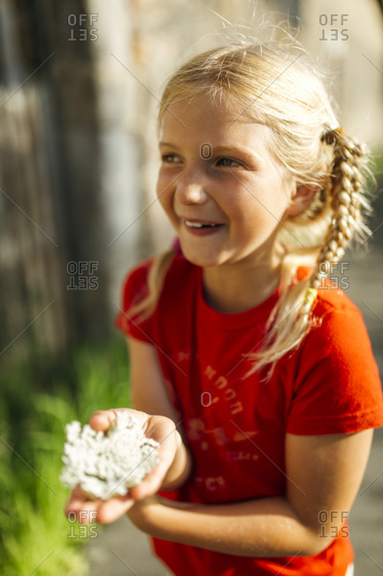 Portrait of smiling little girl with braids