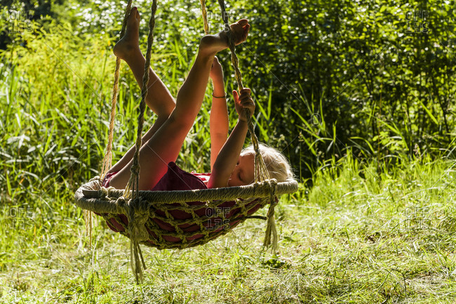 Girl relaxing in nest swing