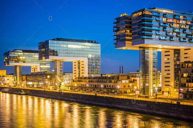 Crane houses at Rheinau harbor by twilight, Cologne