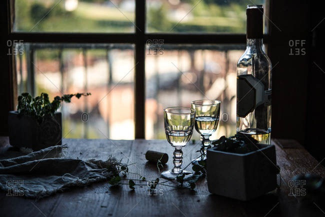 White wine bottle and glasses on table