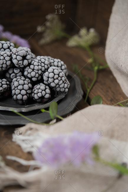 Frozen blackberries on a plate
