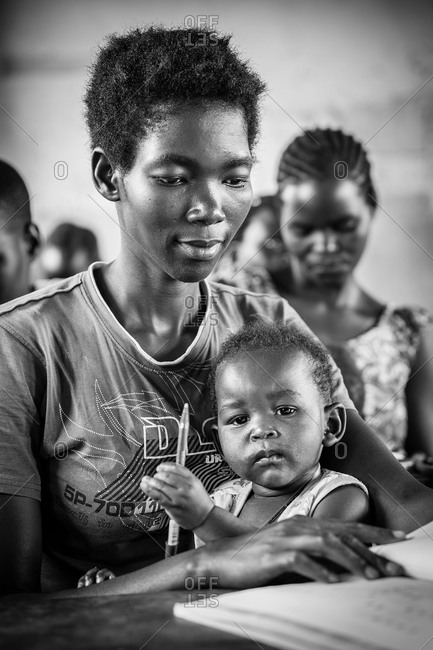 Woman and child in a literacy and numeracy development for youth program