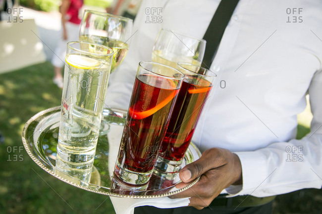 Waiter carrying tray of cocktails in Kent, Connecticut