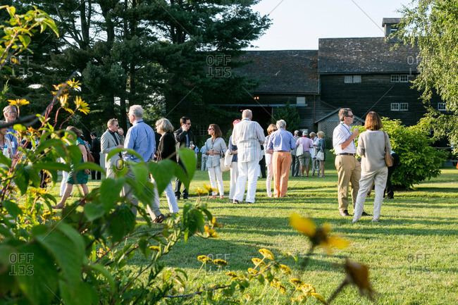 Kent, Connecticut, USA - August 14, 2015: People gathered for a garden party in Kent, Connecticut
