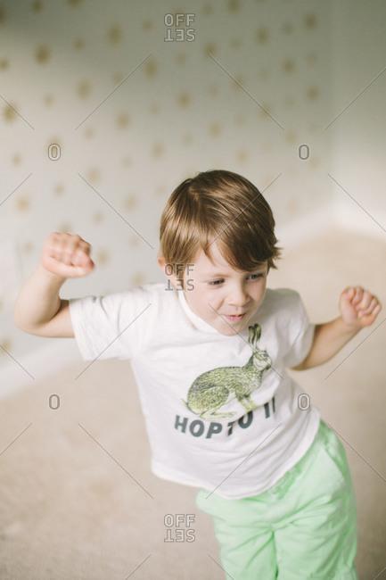 A boy in a bunny shirt dances