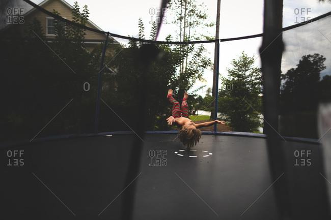 Boy midair in trampoline bounce