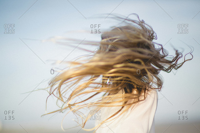 Girl's hair flying wild in the wind