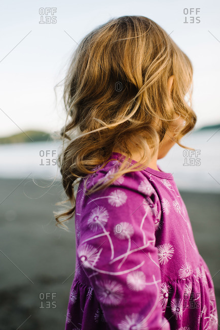A girl turning her head on the beach
