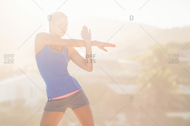 Fit woman doing fitness exercise at the beach
