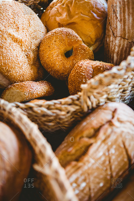 Close up of basket with fresh bread at the bakery
