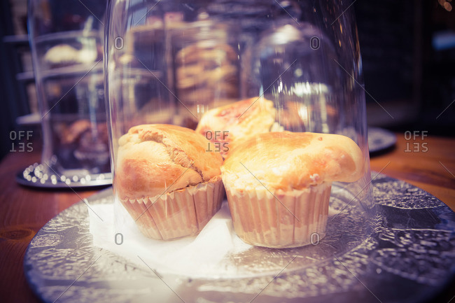 Cakes in display cases in a cafe