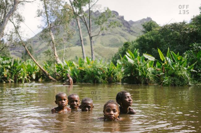 Tolagnaro, Madagascar - March 25, 2015: Children swimming in water in Tolagnaro, Madagascar
