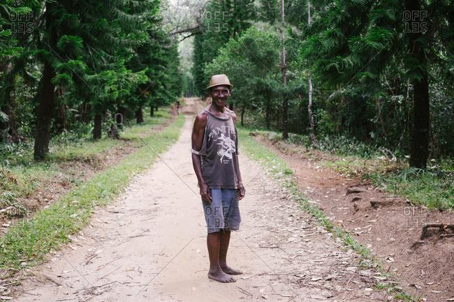 Tolagnaro, Madagascar - March 25, 2015: Man standing on a dirt path in Tolagnaro, Madagascar
