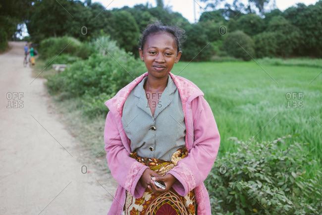 Tolagnaro, Madagascar - March 25, 2015: Young woman on a dirt path in Tolagnaro, Madagascar