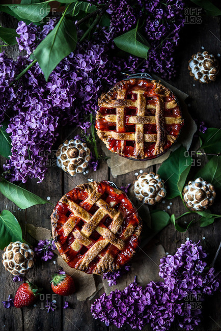 Desserts and clusters of violet flowers