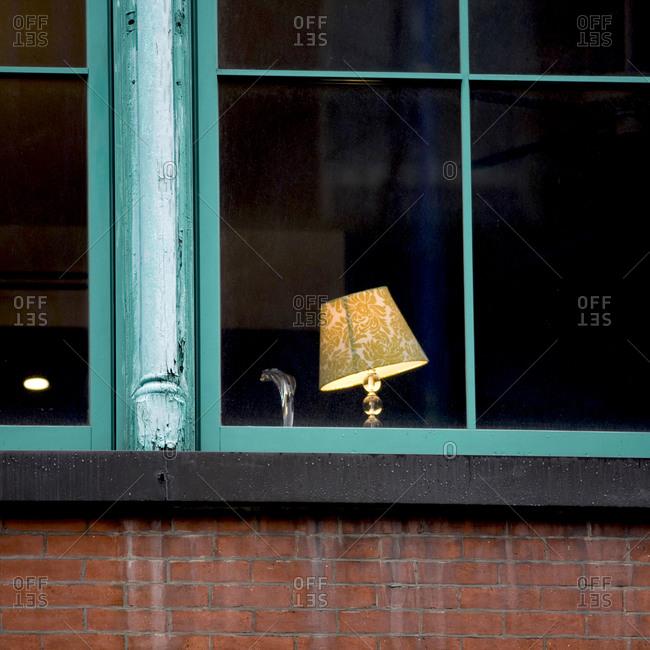 Lit lamp in a window
