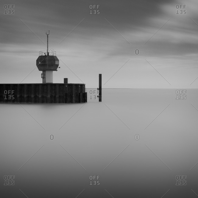 Lookout tower and pier on coast