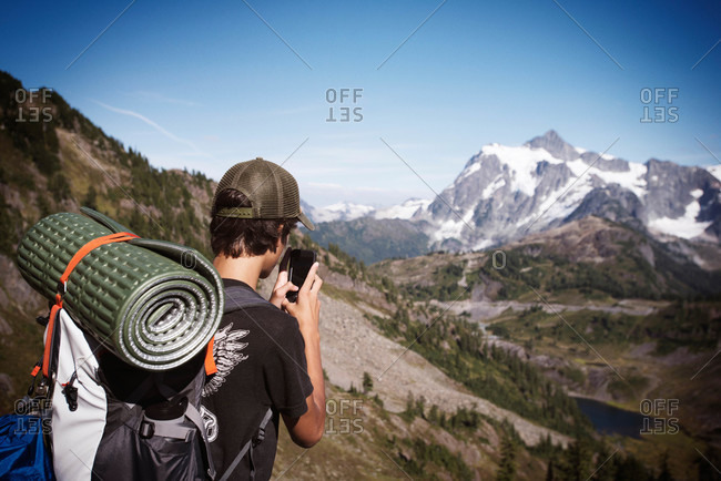 Backpacker taking a photo of the landscape