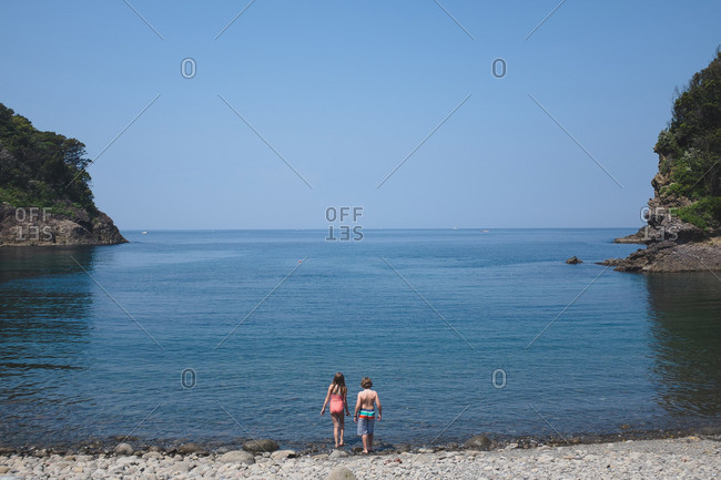 Children at a rocky beach on the Izu peninsula in Japan