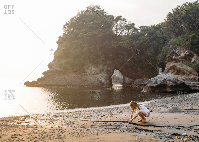 Girl playing on the beach on the Izu peninsula in Japan