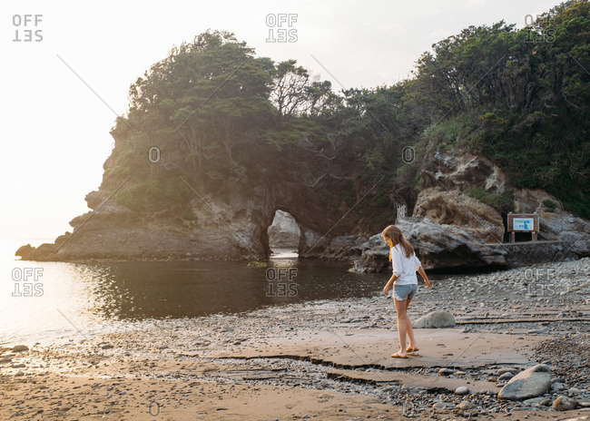 Girl exploring the beach on the Izu peninsula in Japan