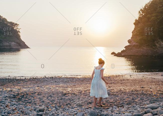 Girl wearing a dress on a Izu peninsula beach in Japan