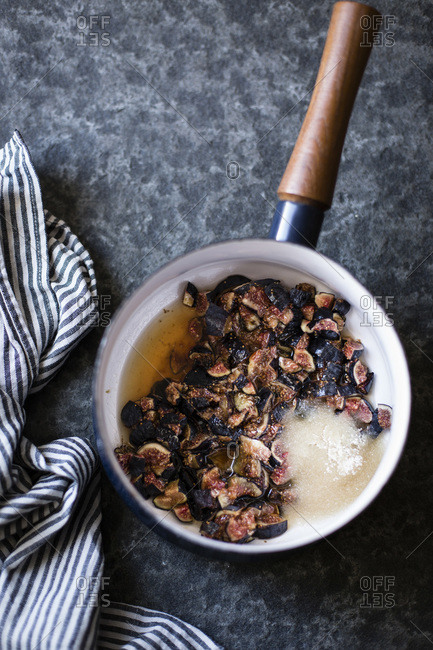 Ingredients for fig preserves in a small saucepan