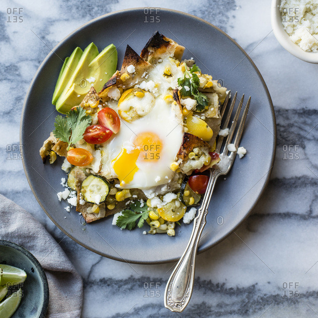 Summer vegetable chilaquiles with egg and avocado