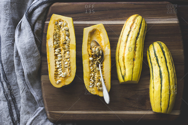 Halved delicata squash with seeds