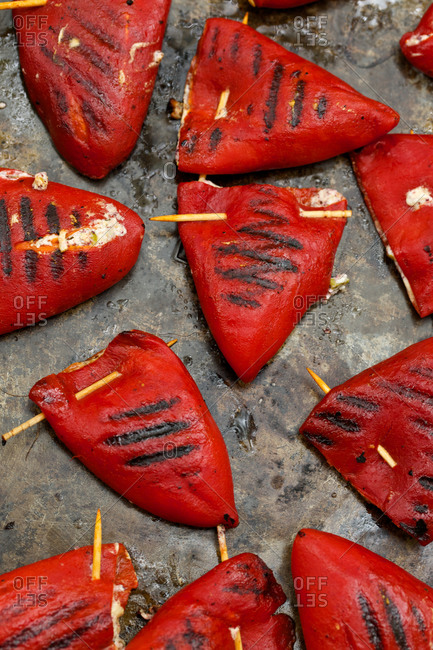 Grilled red peppers stuffed with melted cheese