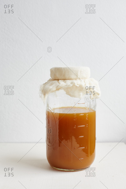 Jar with vinegar covered with cheesecloth