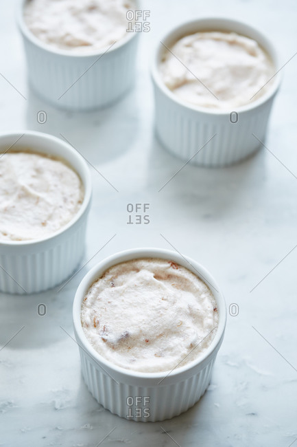 Ramekins filled with raw souffle_ dough