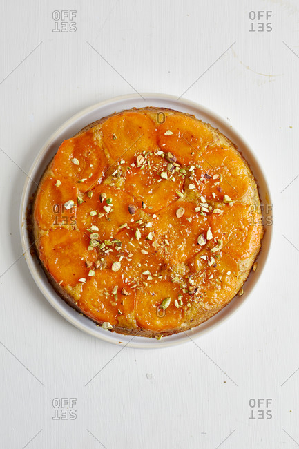 Apricot upside down cake with pistachio nut topping
