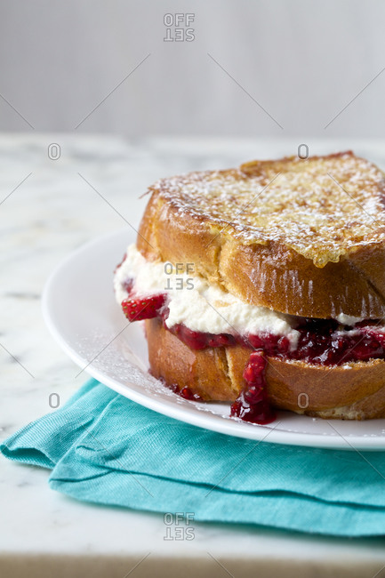 Close-up of plate of french toast stuffed with cheese and fruit